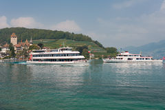 Two passenger ships at the berth of Spiez. Royalty Free Stock Images