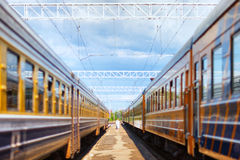 Two passenger trains on one platform Stock Image