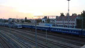 Two passenger trains run towards each other, the top view. Sunset stock video footage