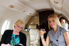 Two passengers relaxing on jet Stock Images