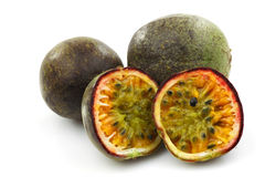 Two passion fruit and two halves Royalty Free Stock Photo