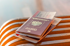 Two passport and tickets on a bench Stock Image