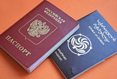 Two passports. Official documents of the Republic of Georgia and the Russian Federation royalty free stock photos