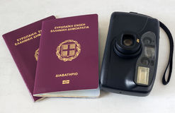 Two passports and a camera. Concept - preparation for travel. Two passports and a camera. Concept - preparation for travel, rest Royalty Free Stock Image