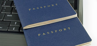 Two passports and computer Royalty Free Stock Images