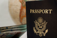 Two passports and a globe. Two passports, one well used one infront of a globe or planetarium royalty free stock images