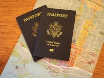 Two Passports and a Map on a Wooden Table Stock Photos
