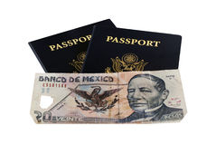 Two Passports with Pesos. Two US Passports with Mexican Pesos Royalty Free Stock Images