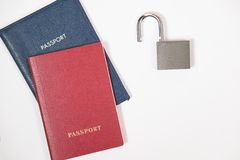 Two passports red and blue with the opened lock Royalty Free Stock Photos