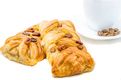 Some pastries filled by honey syrup and sprinkled by pecan nuts. Two pastries filled by honey syrup and sprinkled by pecan nuts with coffee cup Stock Images