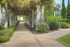Two Pathways with Covered Pillars. Two pathways join in front of covered pillars Stock Photography