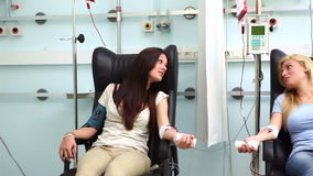 Two patients receiving a blood transfusion. In hospital ward stock video