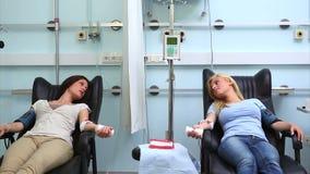 Two patients speaking. In hospital ward stock footage