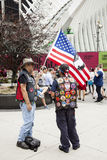 Two patriots near ground zero with flag on 9-11 in new york city Royalty Free Stock Images