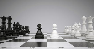 Two pawns in the middle of a chessboard Stock Photography