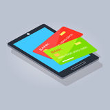 Two Payment Card Lying on Mobilephone or Tablet Stock Images