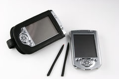 Two PDAs. Pair of PDAs.  One is in a black leather case Royalty Free Stock Photo