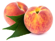 Two peach fruits Stock Photos
