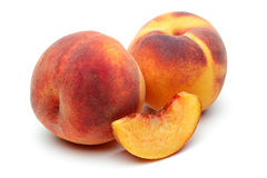 Two Peach and sliced peach Royalty Free Stock Photos