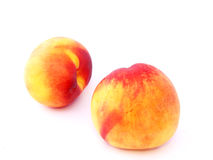 Two peaches. On the white Stock Image