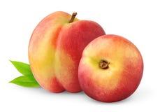 Isolated nectarine peaches. Two nectarine peach fruits isolated on white background Royalty Free Stock Photo