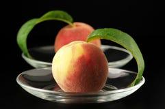 Two peaches Stock Photos