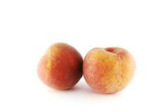 Two peaches. Two juicy peaches on the white background stock image