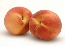 Two peaches. Two fresh peaches on white background Royalty Free Stock Photography