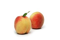 Two peaches isolated. On the white background Stock Photo
