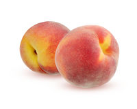 Two peaches with shadow, isolated on white background. Stock Photo