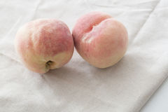 Peaches. Two peaches on the table, closeup Royalty Free Stock Photos