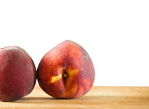 Two peaches on the wooden background, selective focus Stock Photos