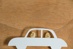 Two peanut figurine travelling in car Stock Photo