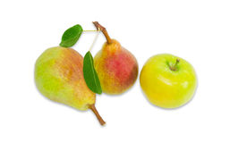 Two pear Bartlett and apple on a light background Royalty Free Stock Images