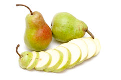 Two Pears And Slices Of A Pear Royalty Free Stock Image