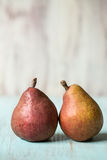 Two Pears On Blue Wood Table Stock Images