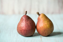 Two Pears On Blue Wood Royalty Free Stock Photography