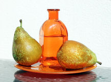 Two pears and bottle with cider Royalty Free Stock Photo