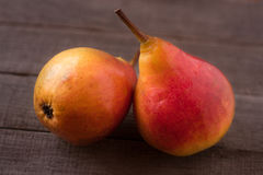 Two pears on a dark wooden background Royalty Free Stock Images