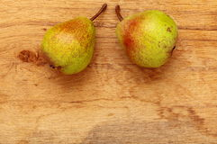 Two pears fruits on wooden table background Royalty Free Stock Image
