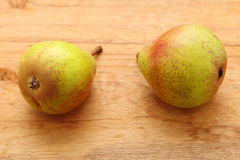 Two pears fruits on wooden table background Royalty Free Stock Photography