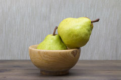 Two pears. Two green pears on wooden bowl Royalty Free Stock Image
