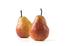 Two pears isolated on white. Two red and yellow pears isolated on white Stock Photography