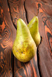 Two pears on an old wooden background Stock Images