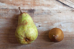Two pears in old wooden background. Lifestile Royalty Free Stock Image