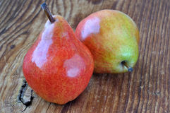 Two pears on a old wooden table Royalty Free Stock Photography