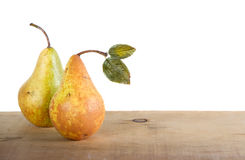 Two pears on a plank Royalty Free Stock Photo