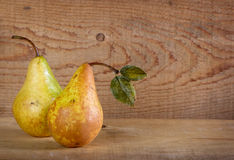 Two pears on a plank wooden background Royalty Free Stock Photography