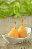 Two pears poached in syrup Royalty Free Stock Image
