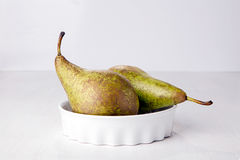 Two pears in porcelain dish Stock Photos